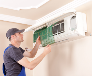 Man installing air source heat pump